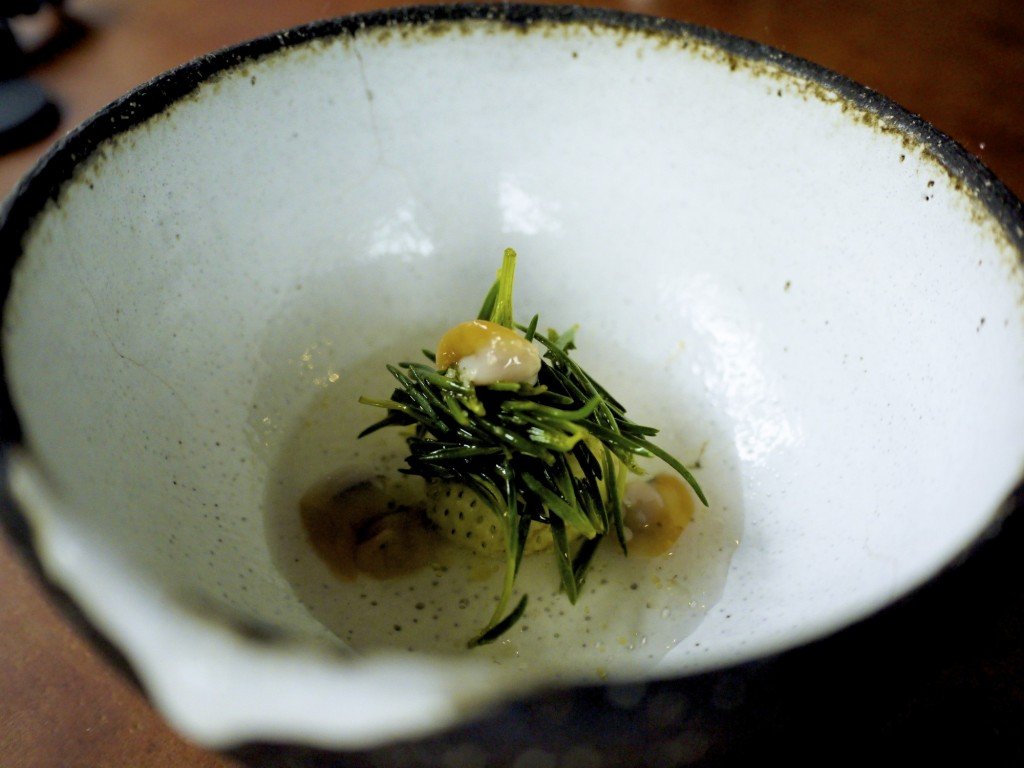 Green strawberry, seaweed, fresh cockles and sea water
